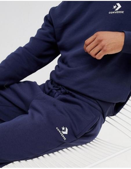 Pantalón de entrenamiento Converse marino de hombre.